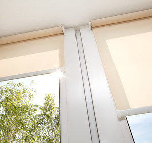 Window with sand coloured roll sun blinds